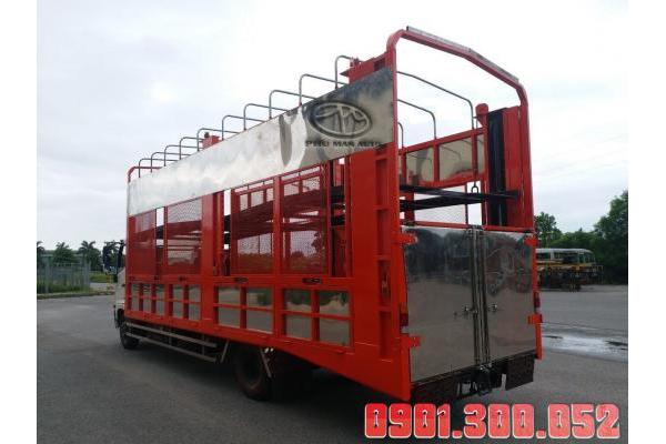 Xe lồng 2 tầng 6.4 tấn Hino FC9JNTA chở ô tô